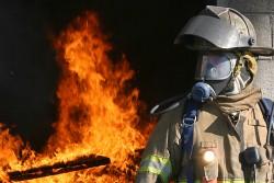firefighter next to fire