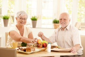 older couple eating healthy meal