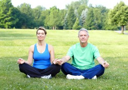 middle aged couple in yoga pose